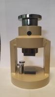 Dispositivo de ensayo a compresión en probetas de...
