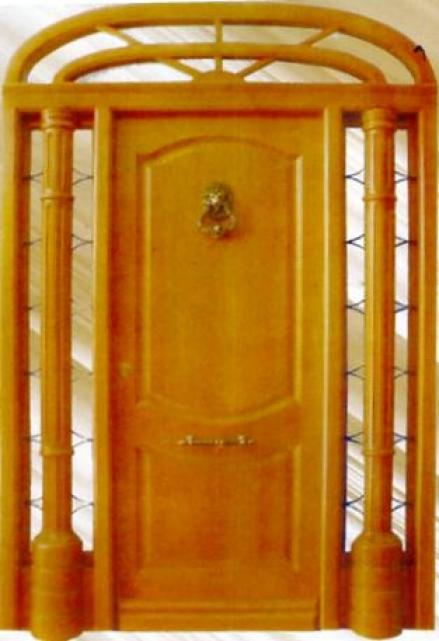 Puerta de exterior de madera maciza rivas almacenes for Puertas madera maciza