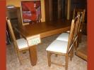 Mesa de salón con 6 sillas.