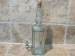 Botella LARIS frasca con grifo metálico 750 mm.