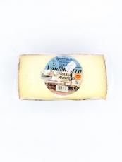 Medio queso manchego artesano viejo de oveja.