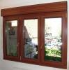 Ventana PVC color madera.