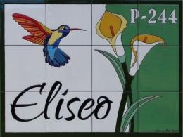 Mural de azulejos de cerámica con colibrí