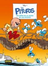 UN NIÑO EN LA ALDEA DE LOS PITUFOS / ESTUDIO PEYO