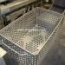 STAINLESS STEEL CAGE WITH HOLES AND WHEELS