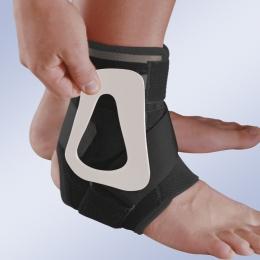 Ortesis de control medio-lateral de la articulación tibio-tarsiana con sistema de contención.