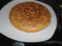 Tortilla de patatas con pimientos confitados