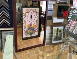 Reloj bordado con espejo